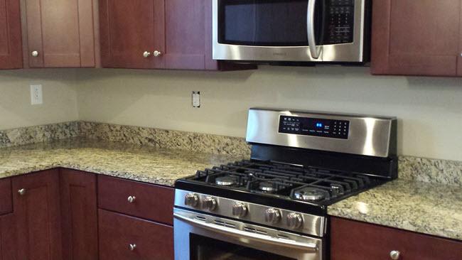 "Kitchen before with a standard 4"" Granite Splash"