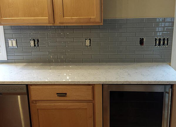 Glass subway tile adds an additional dimension to kitchen backsplashes: it reflects light.