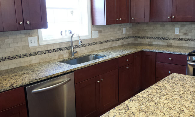 Kitchen backsplash after with a Custom Subway Tile and Glass Mosaic