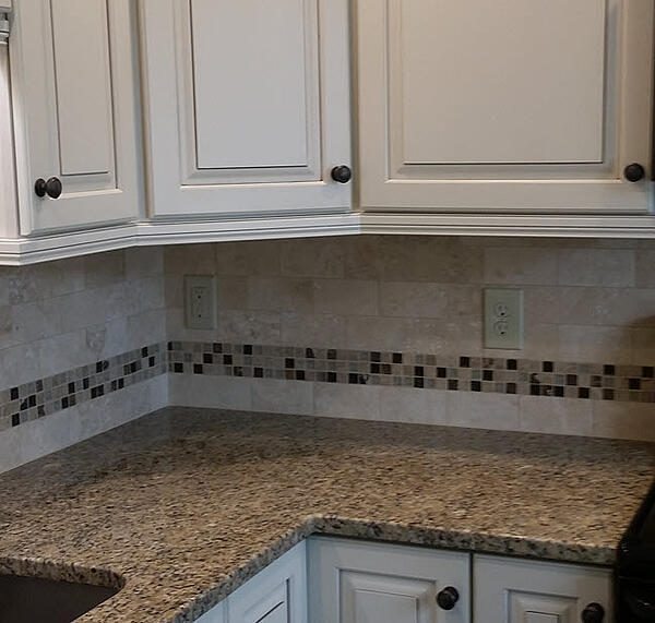 A 3 x 6 Subway tile with 1 x 1 glass mosaic band
