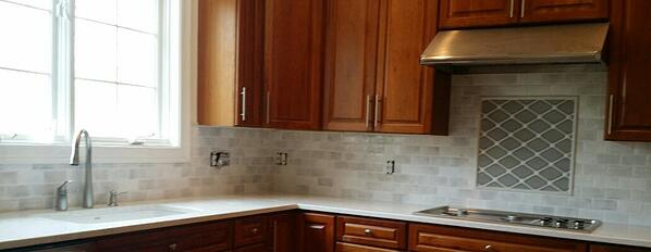 The diamond pattern adds geometric whimsy without overpowering the overall kitchen design.