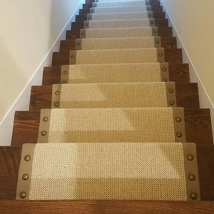 Carpeted stairs with nailheads