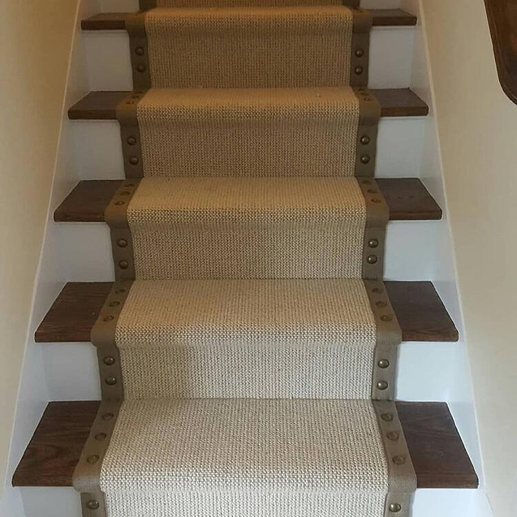 This stair runner features nailheads along the border