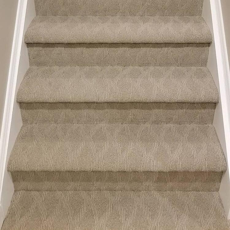 This carpet covers the entire step in a wall-to-wall installation.