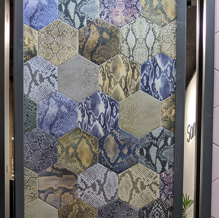And check out this snakeskin-textured wall tile with shades of blue.