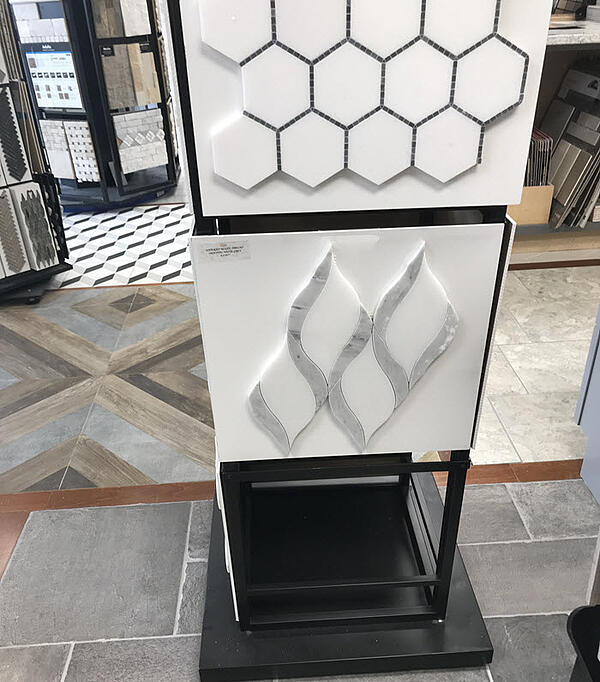 Hexagons and waterjet cut patterns can look very different depending on the grout color you choose.