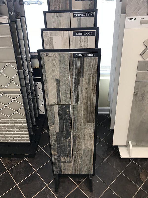 There are so many exciting products to discover at Floor Decor such as these barnwood plank tiles.