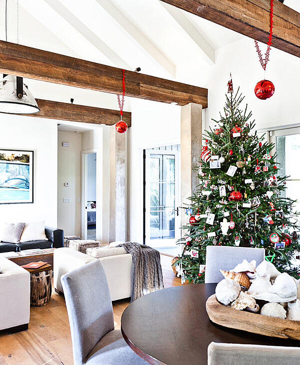 Consider adding touches such as bright red ornaments that hang from the exposed beams
