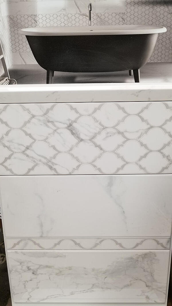 Combine arabesque shapes with rectangular shaped porcelain tiles.