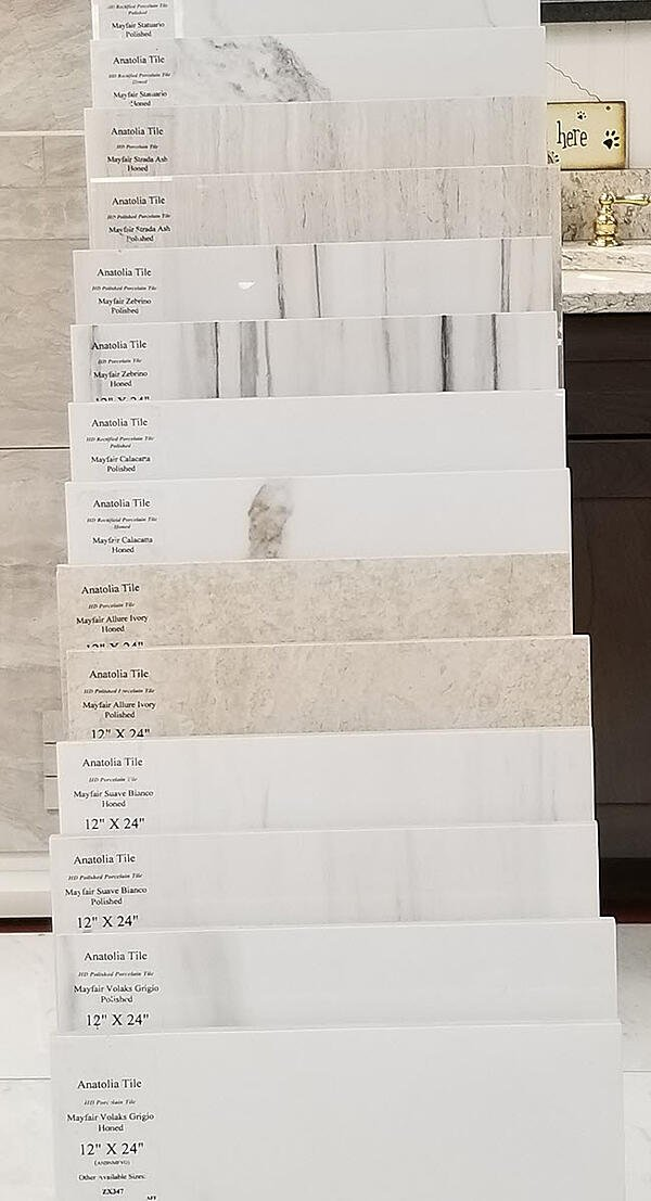 """The display below of 12""""x24"""" tile includes polished, honed and rectified samples in a range of marble patterns and colors."""