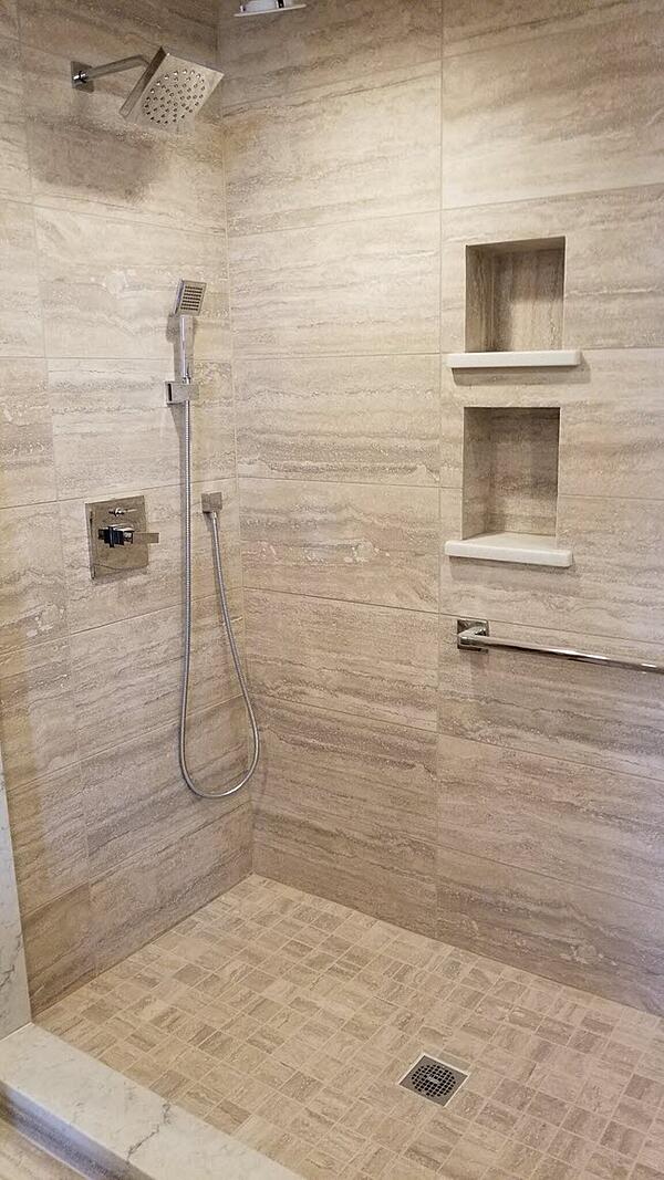 Marble-Look-Tile-ShowerNotice the combination of rectangular wall tile with the small format floor tile.