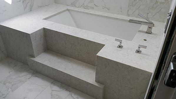 Marble-Look-Tile-TubHAVE YOU CONSIDERED MARBLE LOOK PORCELAIN TILE FOR YOUR HOME?