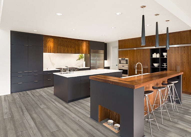Public House in color Southside coordinates well with dark grey cabinets and wood toned countertops.