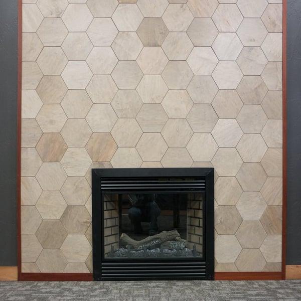 Hexagon wall panel transforms a fire place