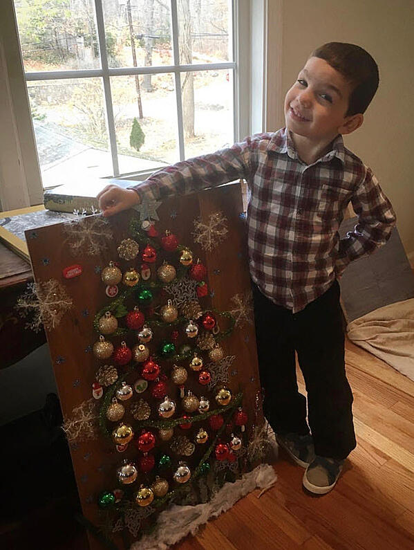 Cole is 5 years old and models his Christmas tree made from ornaments and other fun stuff found at a dollar store