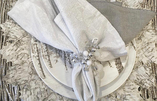 Add birch to the table with placemats and silver linens