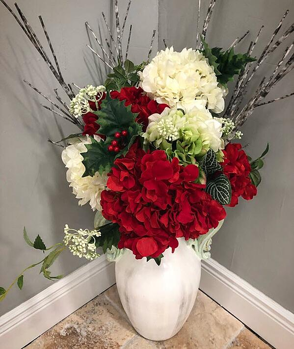 A gorgeous dramatic floral arrangement you can admire in the Middletown, CT showroom