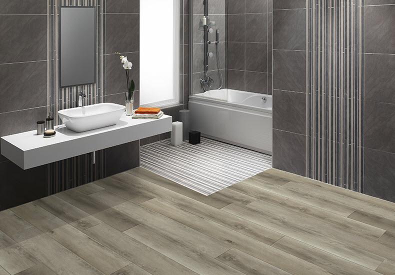 Skyview in color Nimbus adds warmth to this grey-toned contemporary bathroom.