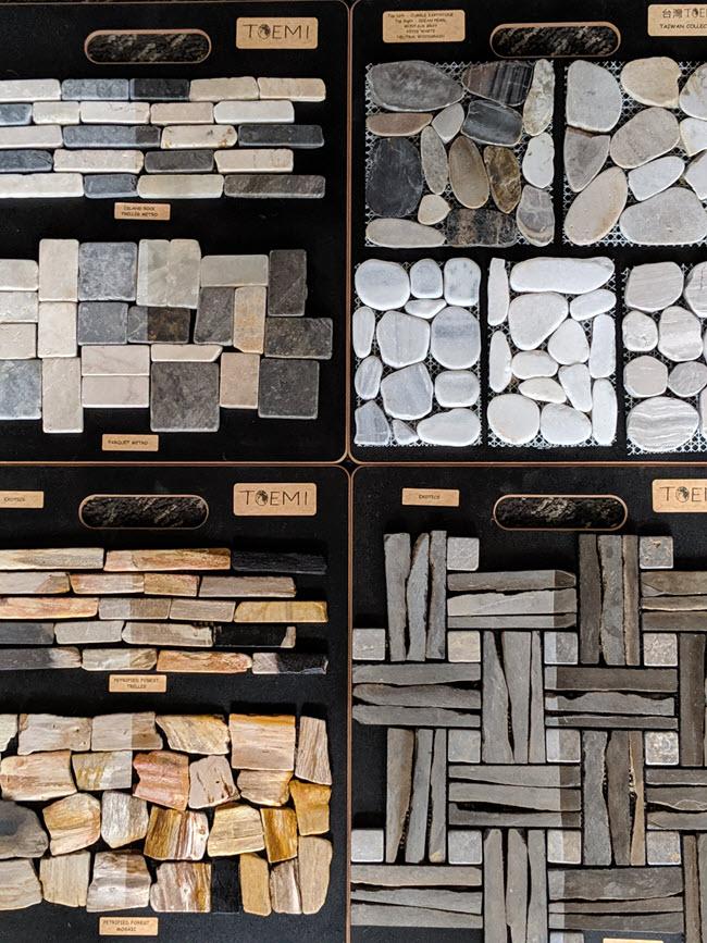 The Toemi Decorative Pebble Tile Collection includes exotics