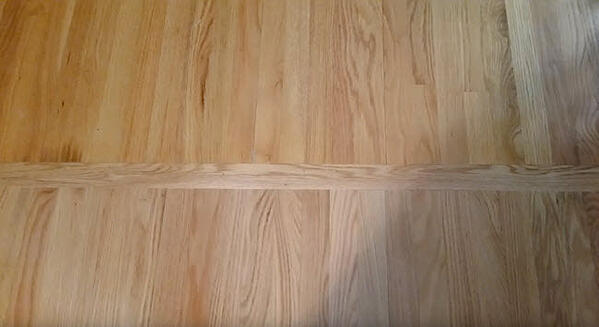 Red Oak Select with vertical board separating Existing Floor to New Floor