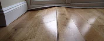 Permanent fixtures such as cabinets can pin the floating floor down, creating a massive pinch point which eventually will cause the floor to buckle.